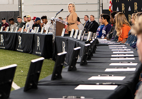 Dr. Janet Dunlop, Superintendent of Schools, addresses BAHS athletes who were recognized during the 2020 National Signing Day celebration Monday.